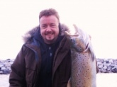 Giant Brown Trout around 20lbs, caught in WI in Late March. It was 33 inches long. When it swam by the boat and i saw how big it was my heart sank, i am just glad i got it in.