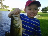 My son Peter (who's met Bill Dance twice) with his second bass ever. 2 pounds 9 oz on a private lake in Kissimmee, Florida