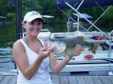 My Stepdaughter, Cassie Heavrin and I were fishing on Lake Barkley this past fall (Sept 2008)while she was taking a much-needed break from school. We were fishing an old roadbed near Eddyville State Prison when she caught this 5lb., 8 oz Largemouth. Initially, I thought she was