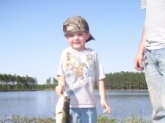I'm Edward Mobley and I'm proud of this piture. This is My 5 year old son Judson with his first bass ever.It was 2.5 pounds but to him it was 20 pounds. He usually fishes for bream but that day he wanted to try to fish with one of my lures,so I let him pick out what he wanted to use.It was a shiner color swim bait by Zoom.