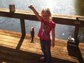 this is paislee holding a largemouth bass caught in a pond in webb alabama