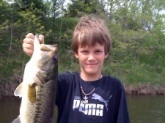 My 9-year old son Jeremy with his 1st bass on his 2nd cast with his new baitcaster combo. 4lb. 4oz.  White spinnerbait at strip pits in Missouri.  He now thinks catchin bass like these will happen every 2 casts. I wish he were right!! :)