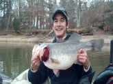My 15 year old son Izak caught this LMB on December 8, 2012 at Tar River Reservoir North Carolina while kayak fishing.  It weighed 10lbs, 7oz and was caught on a Rapala shad rap crankbait at 10:10am.  It was released unharmed...but angry after getting several photos taken!