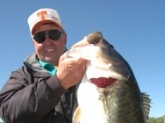 A nice one from a Bill Dance Signature Lake.  Over 14lbs.  This bass is posing with me, Bill Dance.