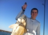 Trevor Dance - Bill's 4th cousin and Mike Dance's son - with a large black drum caught near Port O'Connor...