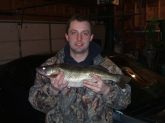 i caught this walleye at the red wing dam in minnesota i never got to weigh the fish but it was twenty six inches long and it was february