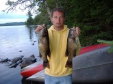 i caught both of these small mouth bass right after each other on a lake off of gunflint lake in northern minnesota in the boundary waters on a black spinner bait with orange blades