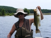 4lb Caught at Quabbin Reservoir in Hardwick, Ma. Mid-day On a #7 yellow perch Jointed Suspending Shad Rap.