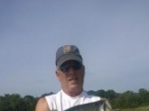 12 pound Large Mouth Bass caught in Florida lake.  Used a top water jerk bait.  Water temp was about 79` and clear day