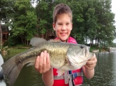 this my grandson carson,this is his first largemouth bass,caught on lake camelot mapleton illinois ,it's weight was 2.4 lbs. carson let him go.