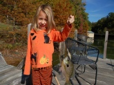 She does not know what is scarier - her Halloween shirt or the giant Bluegill that tried to eat a Bill Dance Fat Free Shad crank bait!