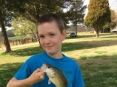 Christian Pence my 11 year old autistic son who LOVES to fish!!! He's Bill's #1 fan and hopes to catch a
