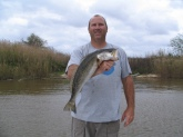 Capt. Lynn Pridgen with a nice speckled trout caught in Mobile river on March 24,2009