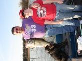 Another picture with me and my son Christian and dog Scruffy and my 11.3 lb Bass.