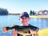 Hey Bill, My name is Bryce.... I'm a young fisherman and I believe my grandpa knows you from awhile back. His name is Dick Sells and he's told me a lot of storyies about you two. Well let's talk about this fish, I caught it On a coffee sented rage tail zoom bug and it put up one good fight. It was about 6-7 pounds and can possibly be my PB.