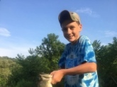 This is my son Charlie his first large mouth bass out of a private stripper cut in north east ohio.