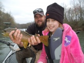 Bill Dance's grand-daughter with her first Brown Trout!