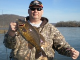 This is my first Susquehanna River Smallie, taken on 4/18/09 at Mongomery Ferry, Pennsylvania, on the Red Baby Tadpole.  She clobbered the lure, and took nearly 5 minutes to land.  She was 19 inches long, 3 pounds, 9 ounces, and was released safely after the photo.