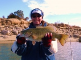 I caught this smallmouth in Navajo Lake in northern New Mexico. She weighed 6lbs. 7oz. and was 21 inches long. I caught it Nov. of 08. In about 15 feet of water, the water temp. was 60. I was fishing a drop-shot, 3in smoke sinko. It was the only fish I caught that day, but worth the being out in cold weather.