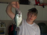 Me and my friends were fishing and we ran out of bait and i casted out a hook with nothing on it and my friends said it would be funny if you caught something on just a hook and i was playing around when i said i caught something and then the next second i did and it was a 2 and a 1/2 pound crappie