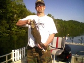 This is a big Dale Hollow smallie. It weighed 5 pounds and was 21 inches. Me and my brother caught 16 on May 10 2009. We had a guide named Randell Gibson. If you ever get a chance to fish Dale Hollow don't pass it up. And we did release all of the fish.