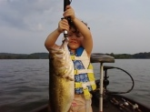 Dani Reeves,3year old,with a 5 lb bass caught in late August on deep structure with carolina rig in Chattanooga, TN.