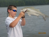 HI,THIS WAS MY FIRST STRIPED BASS.I CAUGHT IT ON A 3 IN. SHINER.
