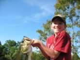 Caleb caught this seven pounder on a soft plastic shad, pearl white, out of an Oklahoma farm pond.