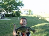the largemouth was caught in a local pond and was 18 inches 4 1/2 pounds it was his largest bass at the time