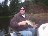 I caught this 1.5lb largemouth on Tenmile Lake in Oregon.  It is my first bass.  I never really bass fished before.  I went a couple of times, a long time ago.  But now i am hooked.  I think bass fishing is the best.  I want to thank Bill Dance for the help his show gives,  he really explains things so it can be understood.