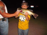 This was a night ill never forget. It was my dad,my son and me. My son  dakota just got done playin a baseball game,and after after the game he came over to me and said can we go fishin tonight dad? Of course i said yes. it was dark by time we got out to the pond, I tied him on a pop-r pearl white.hopin he would catch his first bass! well he did he caught 4 that night!! i was so proud of him. in this picture he is holdin a bass I caught bout a foot off the bank.I had on a black buzz bait and he blew it up!! it weighed 5 lbs  caught in coshocton ohio at 9 30 pm. It was a great night!!!