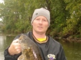 This Smallmouth was caught in the Shell Rock River in Northern Iowa late October 2008 on a Johnson Silver Minnow. The Length was 21 inches We did'nt want to stress the fish so we let it go. The scale was on the other side of the river. We estimate it was close to five pounds.
