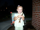Paige Perkins, 3 years old, reeled in her first carp
