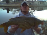 I caught this carp in the Concho River (San Angelo, Texas) on Christmas day 2009. It was below 40 degrees and I was targeting rainbow trout. I was pretty suprised even though I use corn when I am targeting carp too. No weight on the fish and released it.