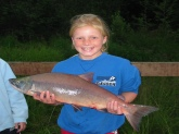 My middle daughter with her first Alaska red salmon.