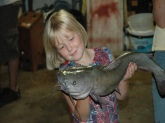 my cousin jayme holding a nice 9.lb catfish i caught on a farm pond in blue grass, iowa