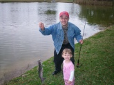 Frankie and 2 yr old daughter Sara with catfish in Pinellas Park, FL - about 1-2 lbs