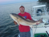 Capt. Lynn Pridgen with a Bull Redfish. Caught in Choctaw Pass in Mobile,Alabama