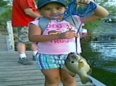 this is clarissa munguia redear sunfish 2.5lbs 11 3/4s long on 4lb test line caught wit a nightcrawer at patagonia,lake in tucson arz...she is 6yrs old...& didnt need no help from dad...game & fish knws...as well as coming on the t.v news & the news paper...we r big big fans keep up the gr8 shows we love u...