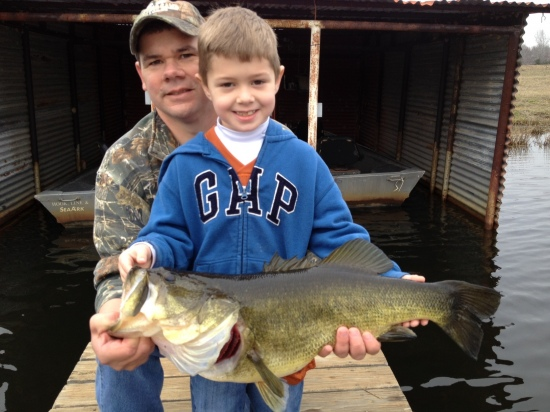 Cole (6) with his 9 lb bass caught on New Years Eve with a live minnow on a Zebco 33