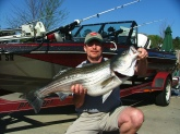 29.5lb, 40inch Striped Bass, Lake Lanier, 04/2005.  Coached cousin in with this fish on his first ever Striped Bass trip, first Striper caught in first hour.  My cousin thought it was hung on the bottom after fighting it for 15 minutes and he tightened the drag just as I yelled no, no, the fish lurched forward with my cousin diving forward with the fish while loosening the drag nearly impaling himself on the bow trolling motor.  Continuing emphatically coaching him to keep the pressure on the fish, he finally pulled it in screaming it's a shark (coming from Florida) when he first glimpsed the striper.  Could not fit it in my net and both of us nearly rolled out of the boat while grabbing each side of his mouth hauling the Striper into boat and the circle hook fell out of the Stripers mouth onto the deck!  I reinforced my coaching with