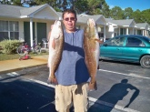 The redfish on the left-side was caught by my buddy Robby it was 24