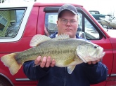I caught this large mouth bass in a lake in Elizabethtown Kentucky with number 5 shad rap in February 2008 the water tep was unseasonably warm  that year ant the bass were shallow my dad, brother, and i caught fish all day long.  the monster was 6lbs 2oz the biggest bass i had ever caught.