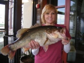 I must have great teachers!  My husband and father-in-law have been teaching me the art of bass fishing.  On my 3rd. trip out I caught this 11.99 pound bass on Lake Ray Hubbard in Rockwall Texas.  She is 27 1/4
