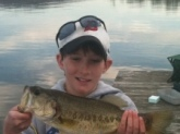 Jackson Paradise from Columbus, Indiana. 3 1/2 pound large mouth bass caught in Lake Guntersville, Alabama