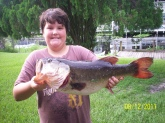 Taylor Creek, Okeechobee,FL. Weight 9.25 lbs, Length 24.5 Girth 18.5. Bait red shad worm 8in. rod bill dance quantam torsion 6.6 med heavy action      Donnie Watson JR 11 years old