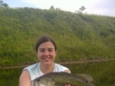 I am proudly submitting this picture of a bass my 18 year olf daughter, Morgan Anderson, caught on Memorial Day weekend 2012.  This came from our strip pits located near Clinton Missouri.  She caught it on a green grass frog.  It weighed 7 lbs 4 ounces.  The bass was released after the photo