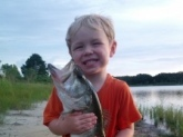 This is Colton and he is two and a half. He already loves to fish and He helped his daddy reel in this 7lb large mouth on a lake behind thier house