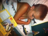 This is my son Clark Gibney after a long day of fishing in Toledo, Ohio. He fell asleep with a Bill Dance book. Clark is obsessed with the sport of fishing and just LOVES to watch videos and read books about fishing. He is 9-years-old and so happy we live near Lake Erie. Susan Gibney