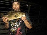 fishing in NEW YORK CITY IS GREAT,,,CENTRAL PARK'S TURTLE POND AT NIGHT TWITCHING MY MR.TWISTER WORM ON TOP OF THE DUCKWEEDS,,,,4LBS ....JC...
